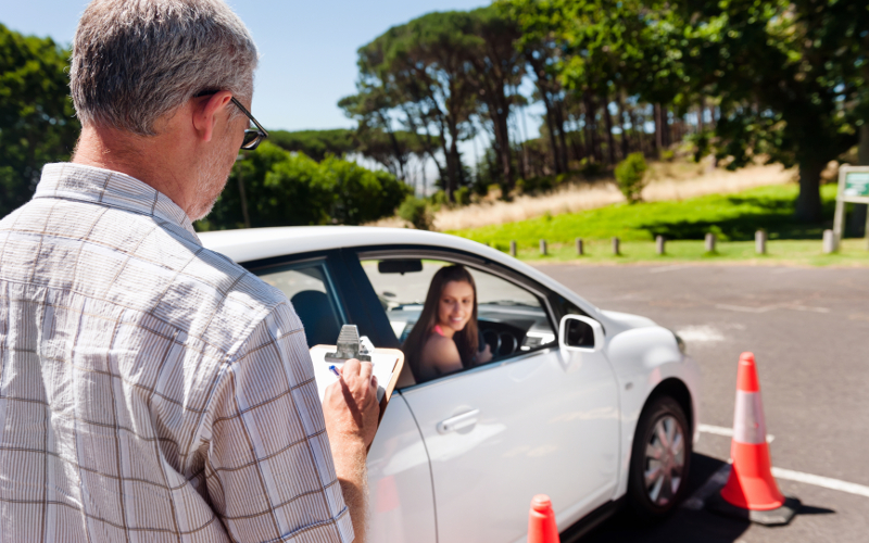 Learner driver girl with intstructor taking lessons